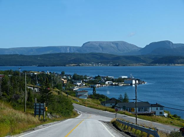 A look at the road, sea, and mountains near Trout Brook Pond in Gros Morne NP