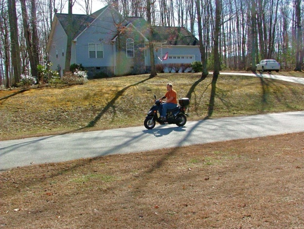 Charlie trying out Chuck's motor scooter in North Carolina