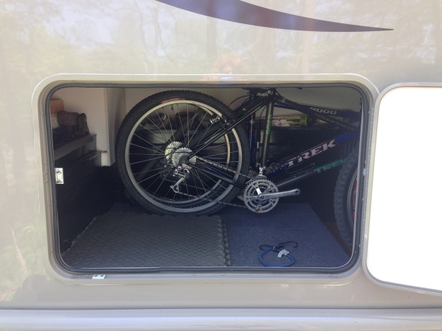 Looking at the bicycle compartment from the back of the camper.